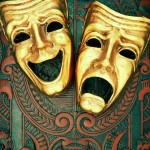 golden-comedy-and-tragedy-masks-on-patterned-leather-david-muir